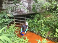 Pulling out the acid mine drainage that's full of iron oxide.
